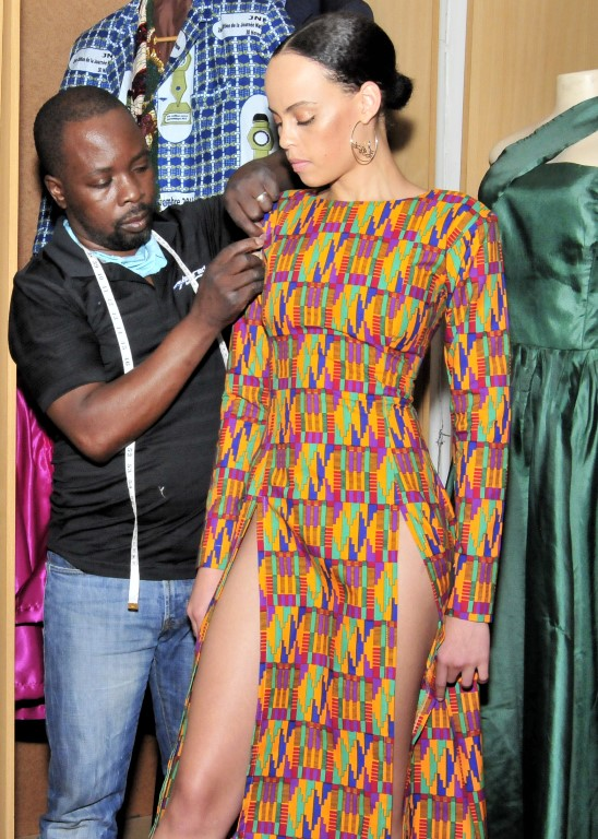 Sunninghill square | Johannesburg, Sandton, Mall, Shopping Centre, Convenient, Near Me, South African, Local, Affordable, Quality Sam The Tailor busy working on a dress, measuring length you of dress ,multi color dress with blue yellow pink ,black dress