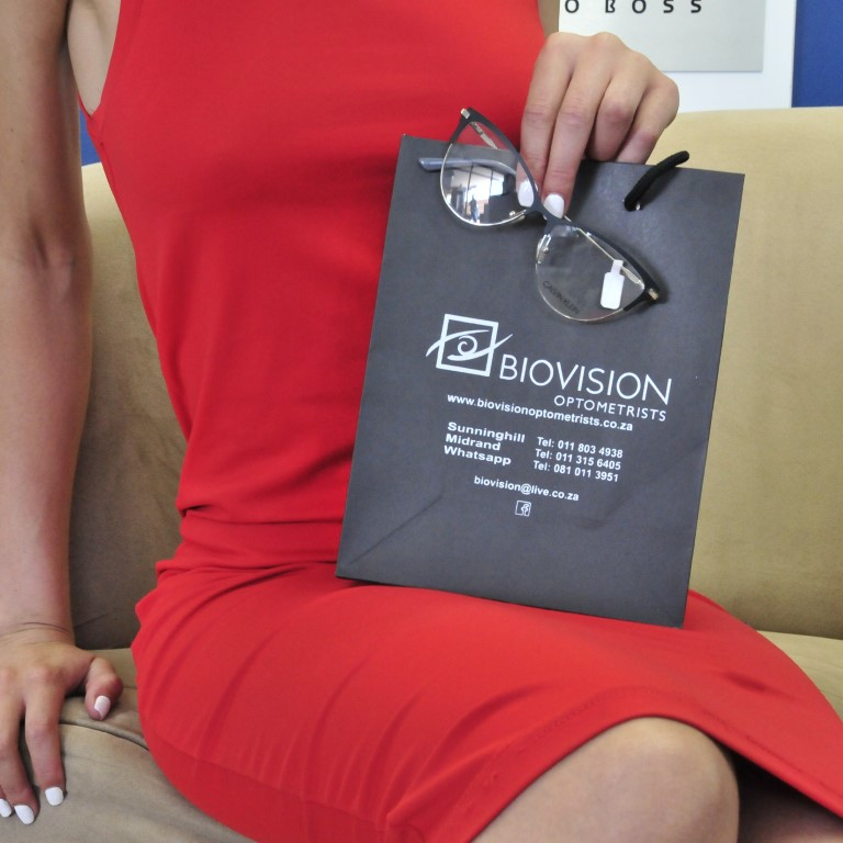 Sunninghill square | Johannesburg, Sandton, Mall, Shopping Centre, Convenient, Near Me, South African, Local, Affordable, Quality ,bio vision bag with reading glasses, lady with red dress