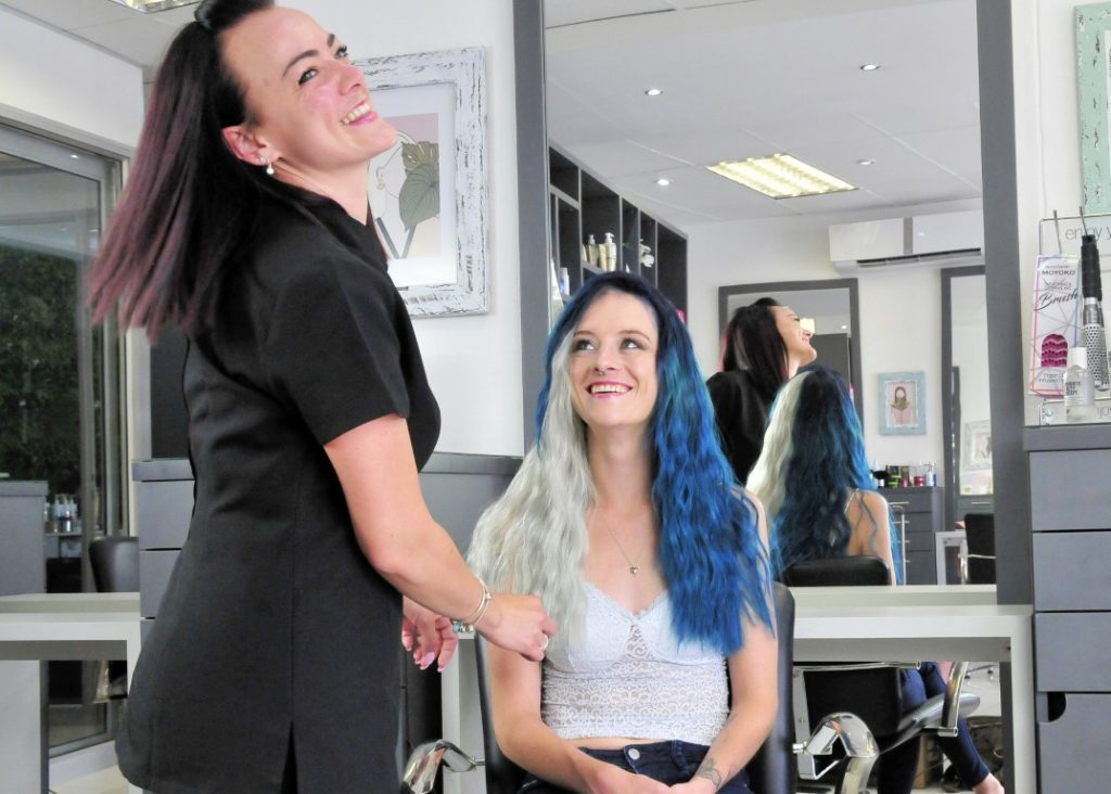 Sunninghill square | Johannesburg, Sandton, Mall, Shopping Centre, Convenient, Near Me, South African, Local, Affordable, Quality Colour rush, White millenial with blond and blue hair, hair dresser smiling at camera